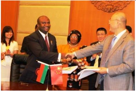Malawi's Minister of Energy Ibrahim Matola finalises energy deal with Chinese company TBEA (courtesy of Malawi News Agency)